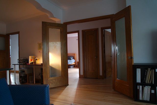 Our Living And Dining Room Is A Long Rectangular With French Doors Opening To The Hallway Near Main Apartment Entrance Single Door At